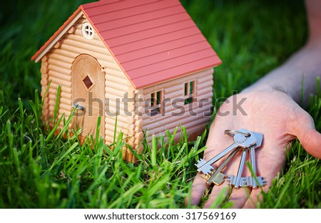 toy model of wooden house - stock photo