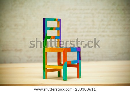 Toy multicolored wooden chair. Art handmade - stock photo