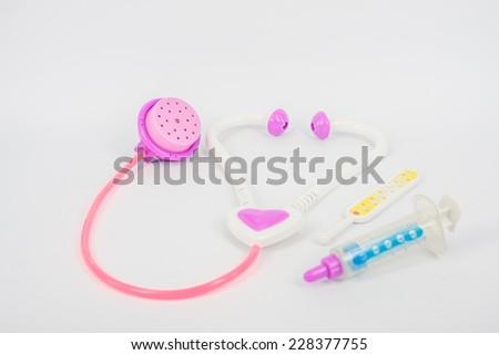 toy of stethoscope syringe on white background pastel color tone,  - stock photo