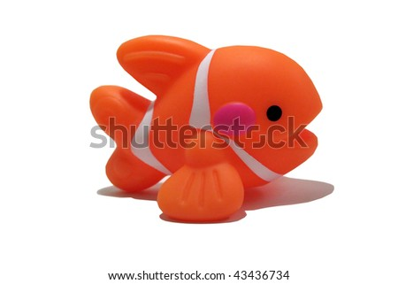 toy orange fish that has been isloated - stock photo