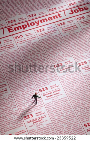 Toy person seeking job employment in newspaper ads - stock photo
