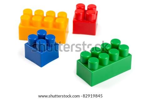 Toy plastic building blocks isolated on white - stock photo