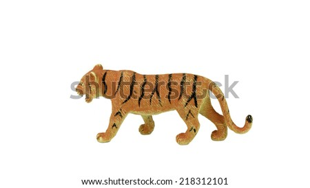 Toy plastic tiger. Isolated on white background. - stock photo