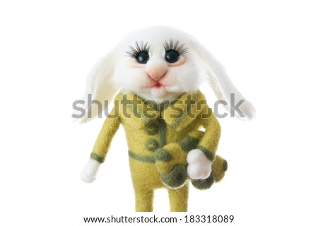 Toy rabbit. Gift for holiday. Easter Bunny on white background. Handmade Felt. - stock photo