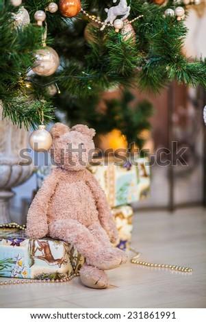 toy rabbit under the Christmas tree - stock photo