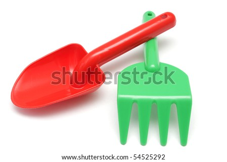 Toy red shovel and green rake isolated on white background - stock photo