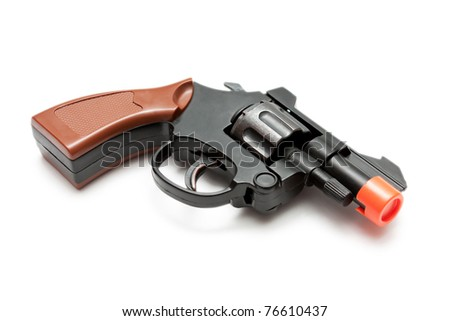 Toy revolver isolated on white - stock photo