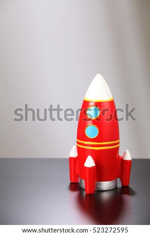 toy rocket on the black table top
