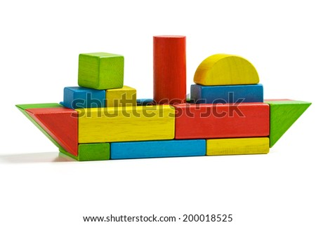 toy ship wooden blocks, shipping multicolor freight, isolated white background - stock photo