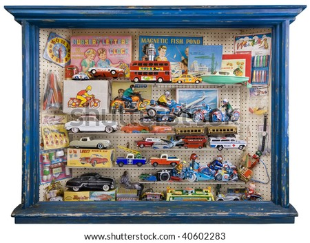 Toy shop window full of tin plate and other retro toys and games. - stock photo