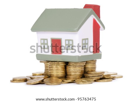 Toy small house and coins . concept - stock photo