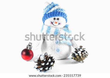 toy snowman and Christmas tree decorations and cones - stock photo