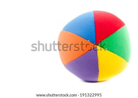 Toy soccer ball made from multicolored patches of cloth - stock photo