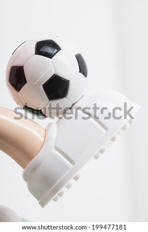 toy soccer ball on his leg