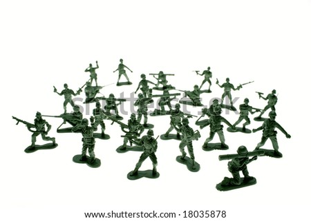 Toy soldiers over white - stock photo