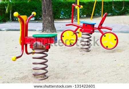 toy  spring rocking in playground - stock photo