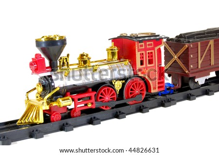 Toy Steam Train and freight wagon - stock photo