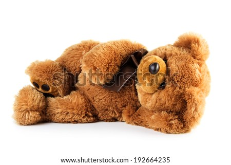 Toy teddy bear lying isolated on white background - stock photo