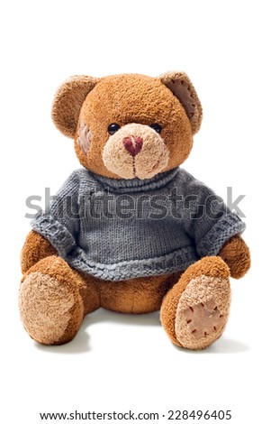 toy teddy brown bear with patches in green sweater isolated on white background - stock photo