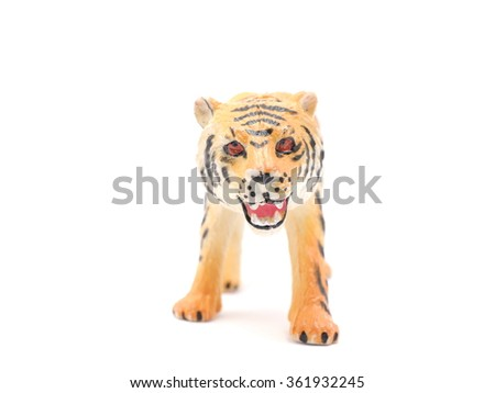 toy tiger on a white background - stock photo