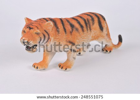 Toy- tiger on white background - stock photo