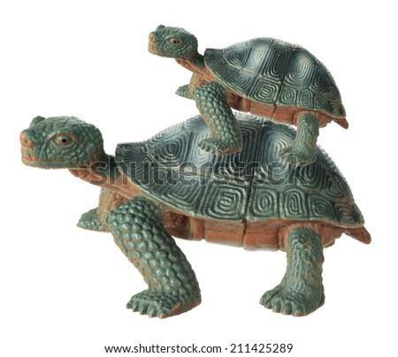 Toy Tortoises on White Background - stock photo