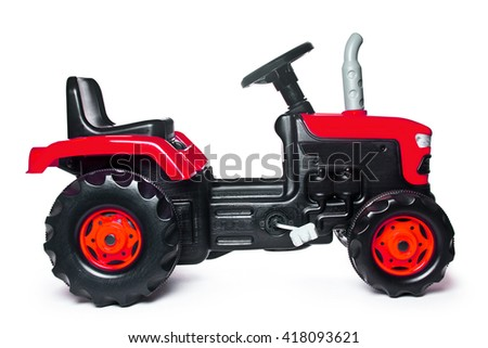 toy tractor on a white background - stock photo