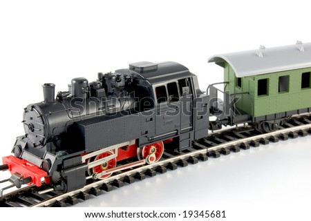 Toy Train and and passenger coach on white background - stock photo