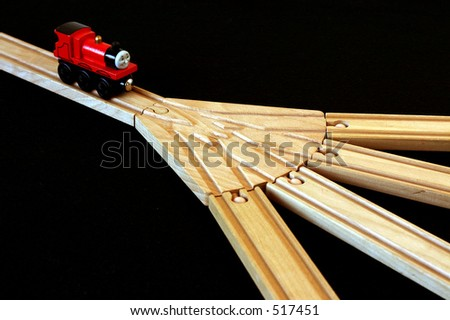 Toy train engine and track - stock photo