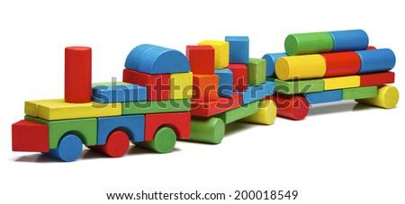 toy train goods van, wooden blocks cargo railway transportation, isolated white background - stock photo