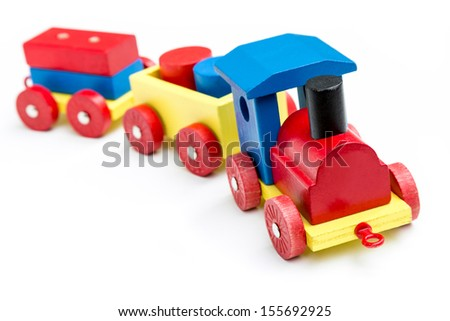 Toy train in bright colors. - stock photo