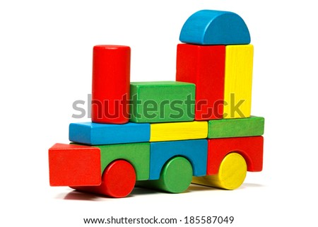 toy train, multicolor locomotive wooden blocks, transport over white background  - stock photo