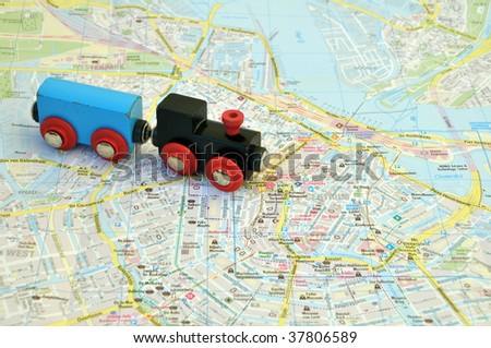 Toy train on the map of the city - stock photo