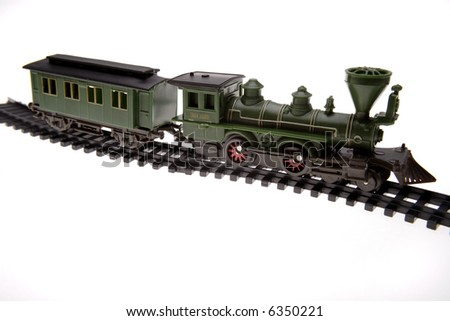 Toy train on track over white - stock photo