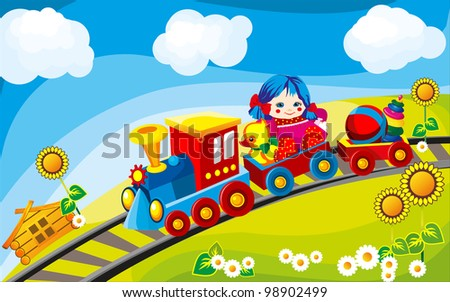 toy train rides on the field in the cars driven by Children's Toys