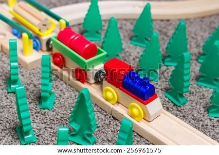 Toy train wooden railway tracks - stock photo
