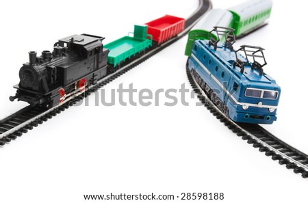 Toy trains and railroad isolated on white background - stock photo
