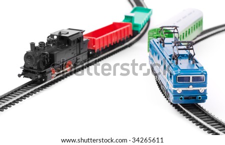 Toy trains on railroad isolated on white background - stock photo