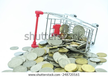 Toy trolley and coins with white background - stock photo