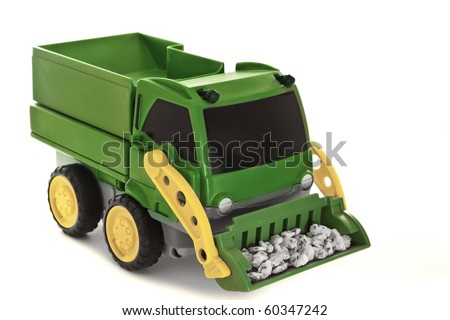 toy truck carrying rocks isolated on white