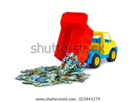 Toy truck with puzzle isolated on white background - stock photo