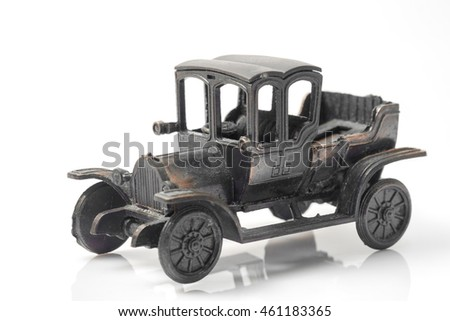 Toy vintage car on white background.