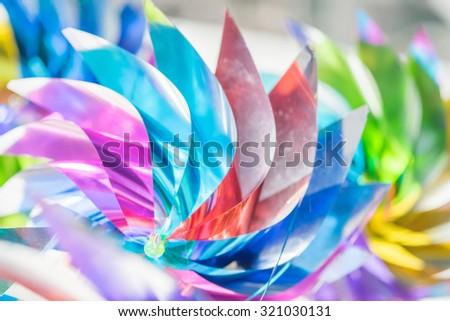 Toy wind turbine blurred - stock photo