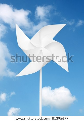 toy windmill  over blue sky - stock photo