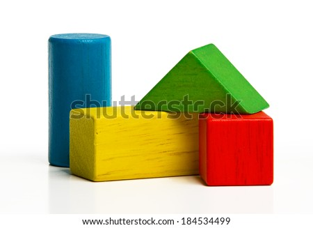 toy wooden blocks, multicolor building construction bricks over white background  - stock photo