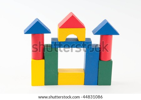 Toy wooden castle on white background