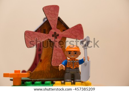 toy wooden painted with colored inks windmill - stock photo