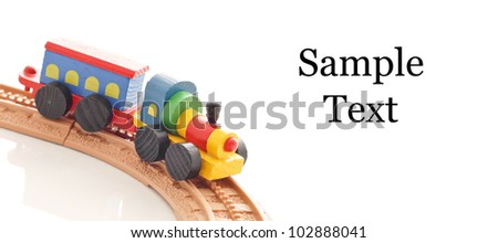 Toy woodenn Train Going Around Bend - stock photo