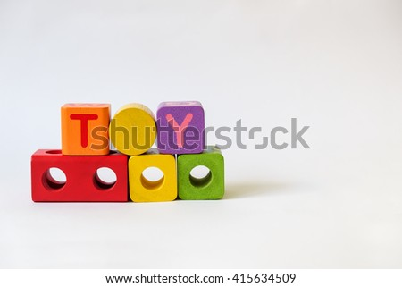 TOY word written on wood blocks, white background with copyspace - stock photo