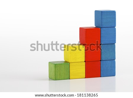 Toys blocks as step stair, multicolor wooden ladder building bricks over white background  - stock photo